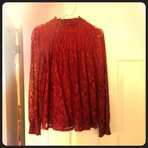 Long sleeve red lace blouse.